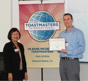 Siri Payakapan, Lt. Governor Marketing presents Charter Certificate to Brandon Roberts, Club President